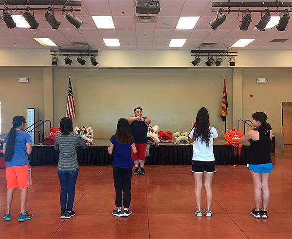Kevin Lau teaching the lion dance