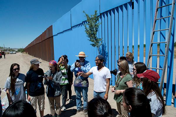 Robert Uribe speaking at the border wall.